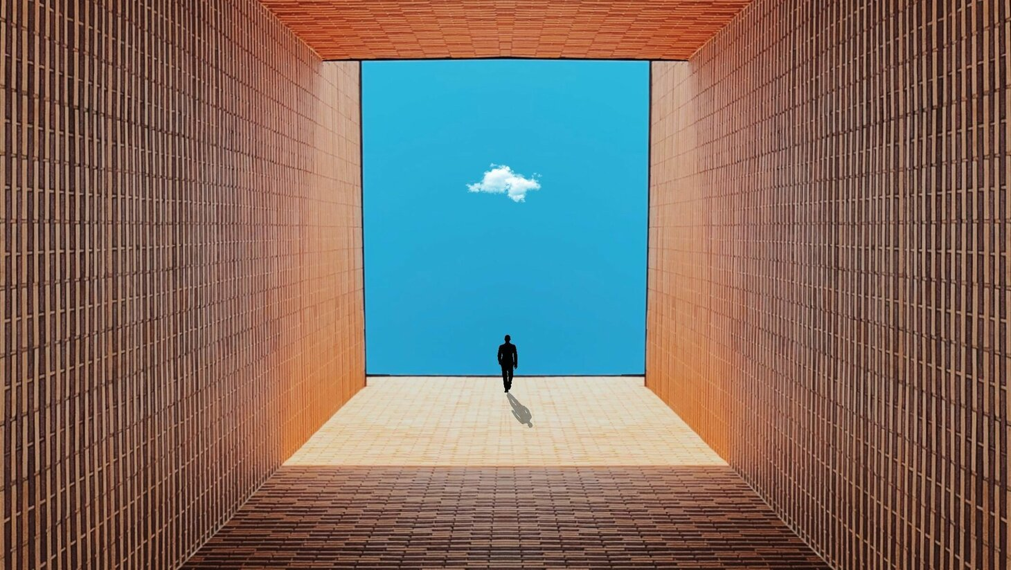 Silhouette of person on brown tunnel across white cloud scopio cb49ca70 4d6f 4988 938e d94451c89154